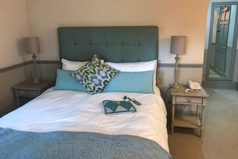 The Winning Post Winkfield duck egg blue headboard blanket and pillows
