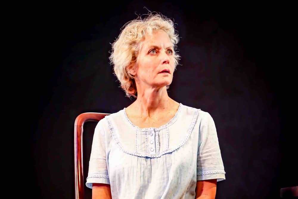 The Anastasia File Theatre Royal Windsor Jenny Seagrove actress wearing nightgown sat on chair looking overwraUght