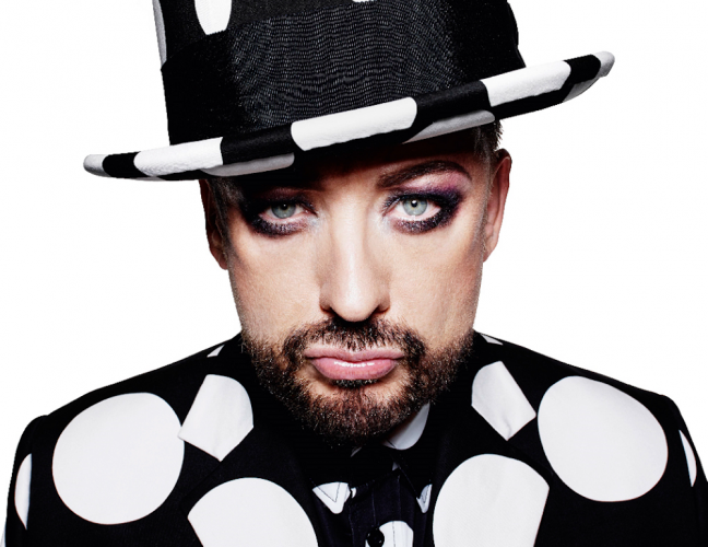 Singer boy george in black and white spotted suit and hat
