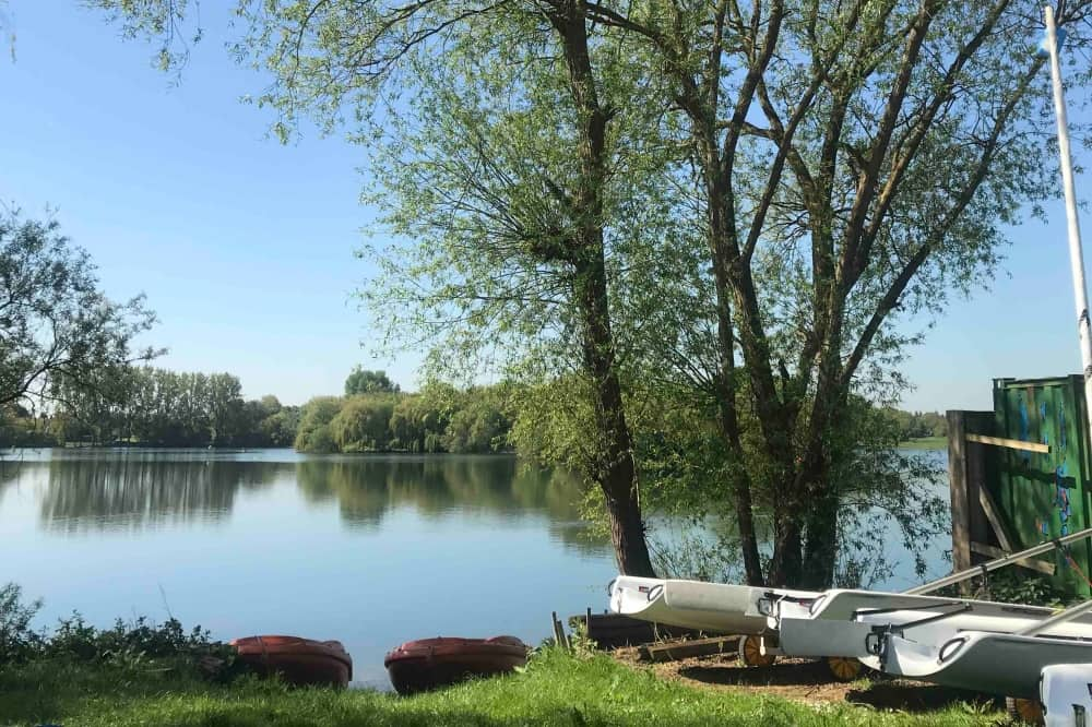 Bray Lake Watersports Bray Berkshire willow tree lined lake paddle boarding sailing wind surfing and more