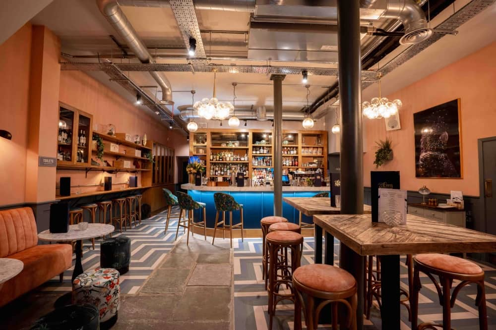 The Corn Stores Reading ground floor bar area stools and high tables geometric floor tiles and industrial details