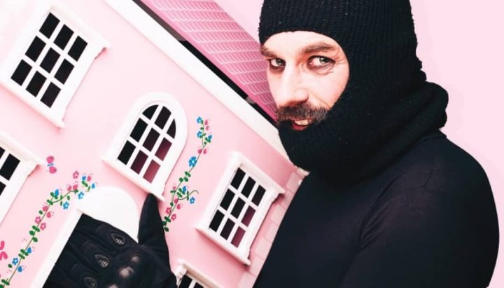 Eddie Summer School of Burglary comedian in balaclava pink dolls house