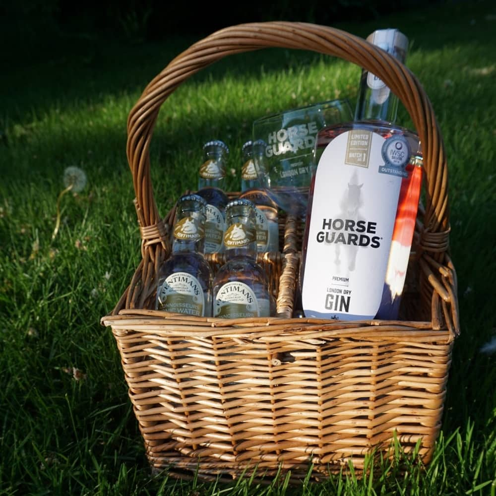 Horse GUards Gin in picnic basket with tonic and gin balloons