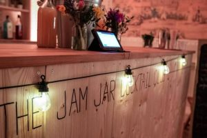 Jam Cocktail Club wooden bar draped in fairy lights