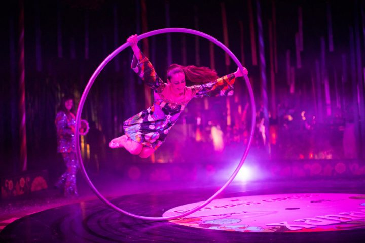 Giffords circus Xanadu circus acrobat performing in giant hoop