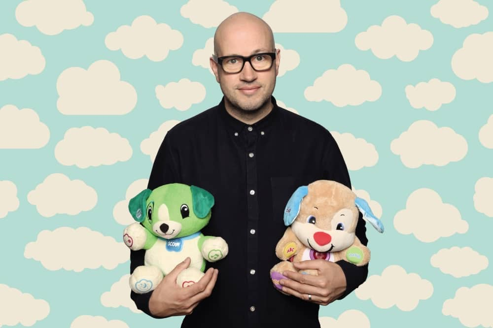 Sam Avery The Learner Parent bald man holding teddies and cloud background