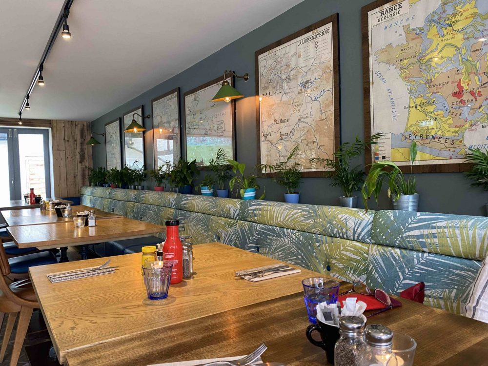 PALM PRINT BANQUETTE AND VINTAGE MAPS THE DOLPHIN NEWBURY