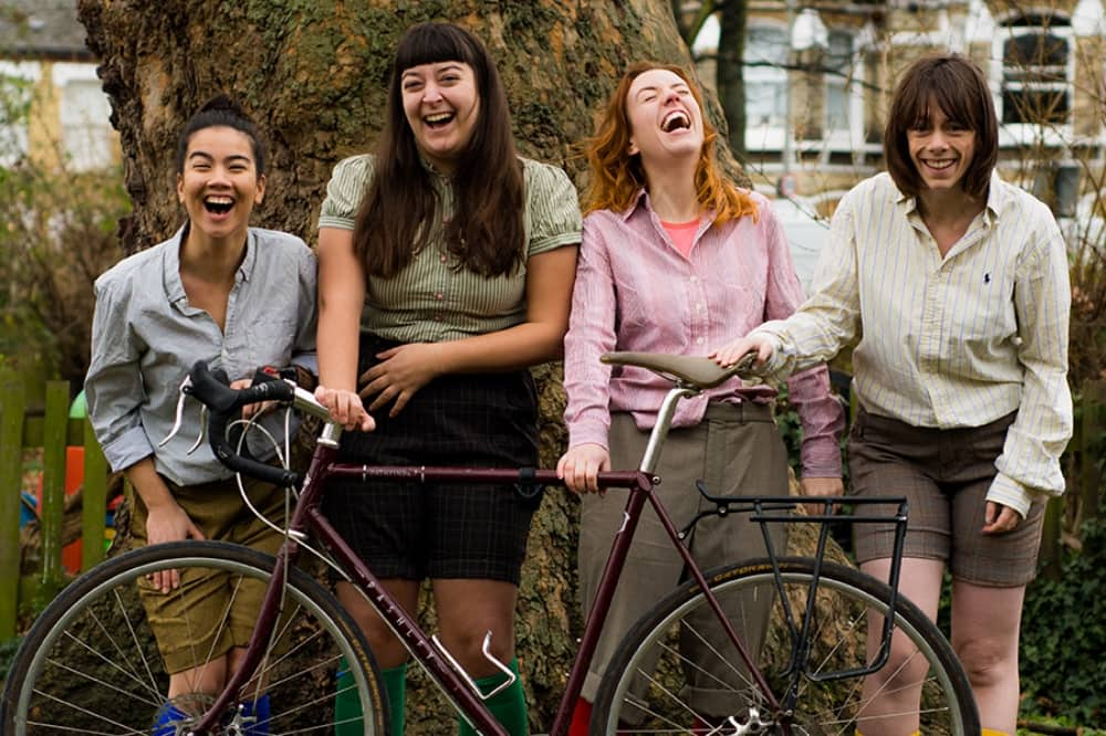 The HandleBards female Troup with bicycle The tempest Norden farm Maidenhead