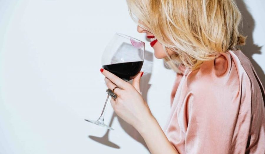 Blonde woman with glass of red wine