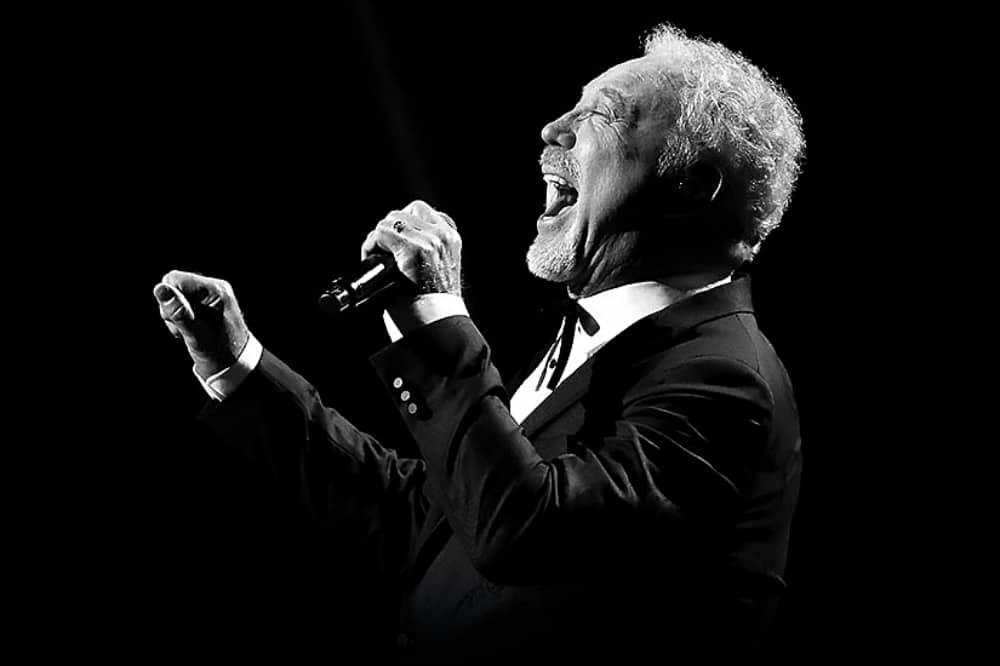 Welsh singer Tom Jones singing in black siot image in black and white