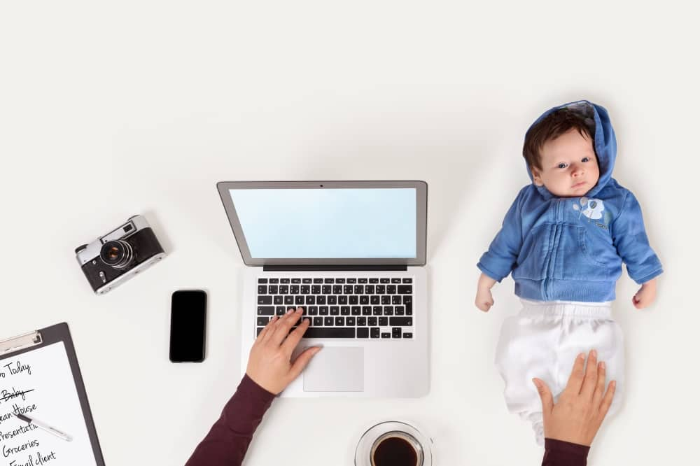 WORK LIFE BALANCE WOMAN AT DESK WITH BABY