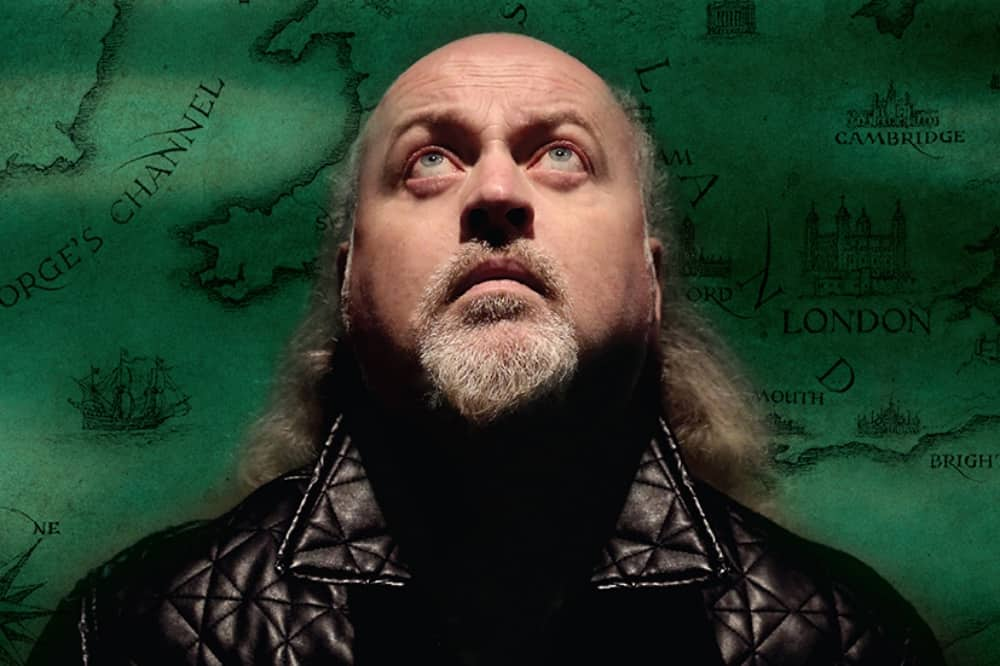 comedian bill bailey bald head beard and green map background