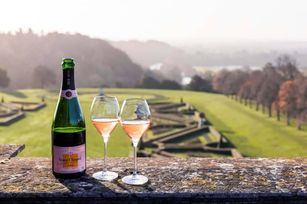 Bottle of veuve cliqout two flutes view of south parterre cliveden house