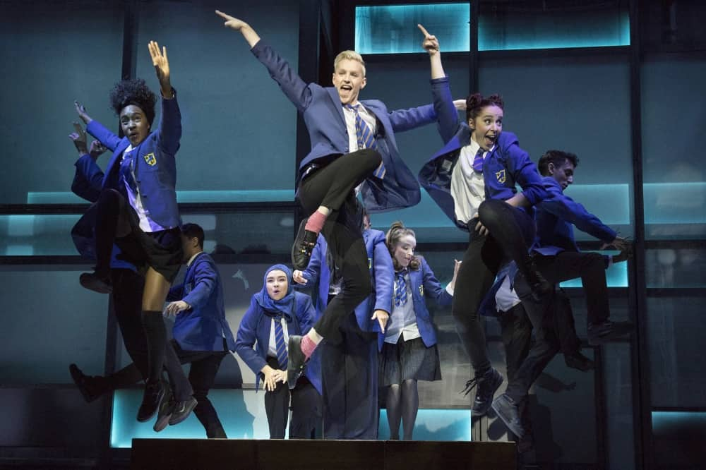 Everyone's Talking About Jamie cast dancing in scholl uniform on stage