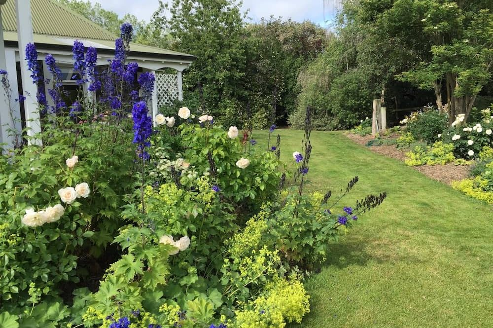 floral country cottage garden lawn summer house and floral beds