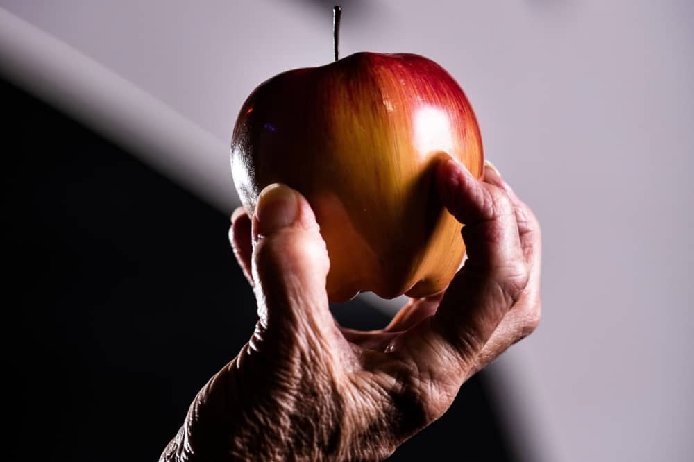 Grimm Tales South Hill park Bracknell old hand holding an apple