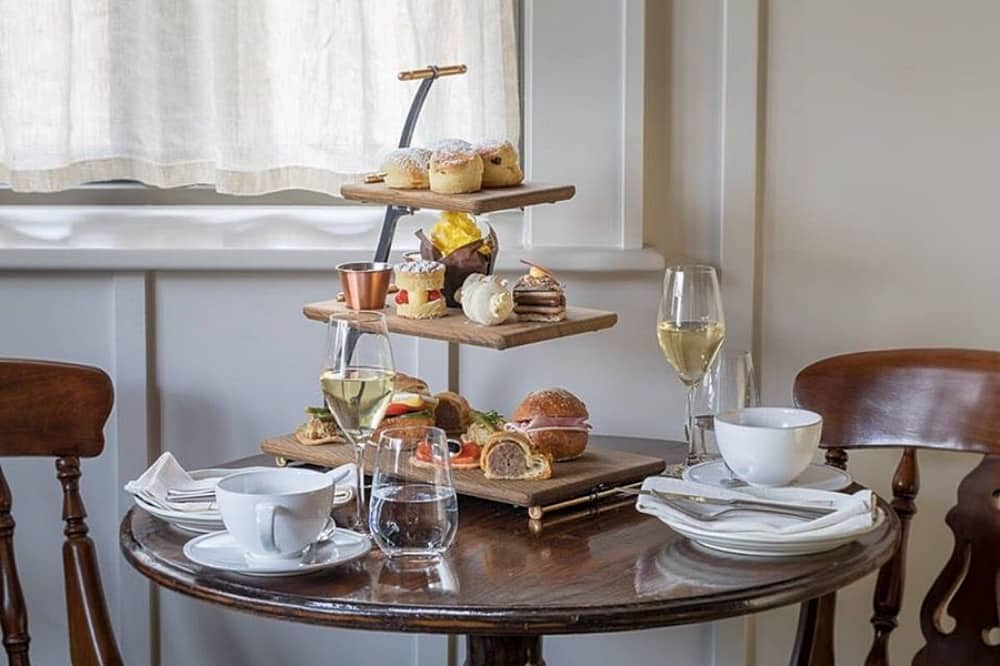 Hurley House Afternoon Tea wooden tiered cake stand on dark wood table