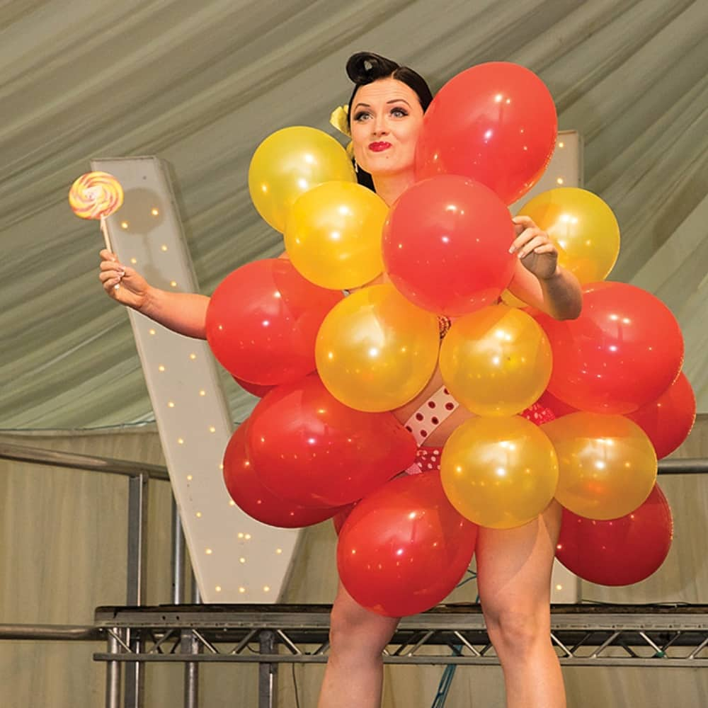 RETRO FESTIVAL NEWBURY CABARET WOMAN WEARING BALLOONS TO BE POPPED