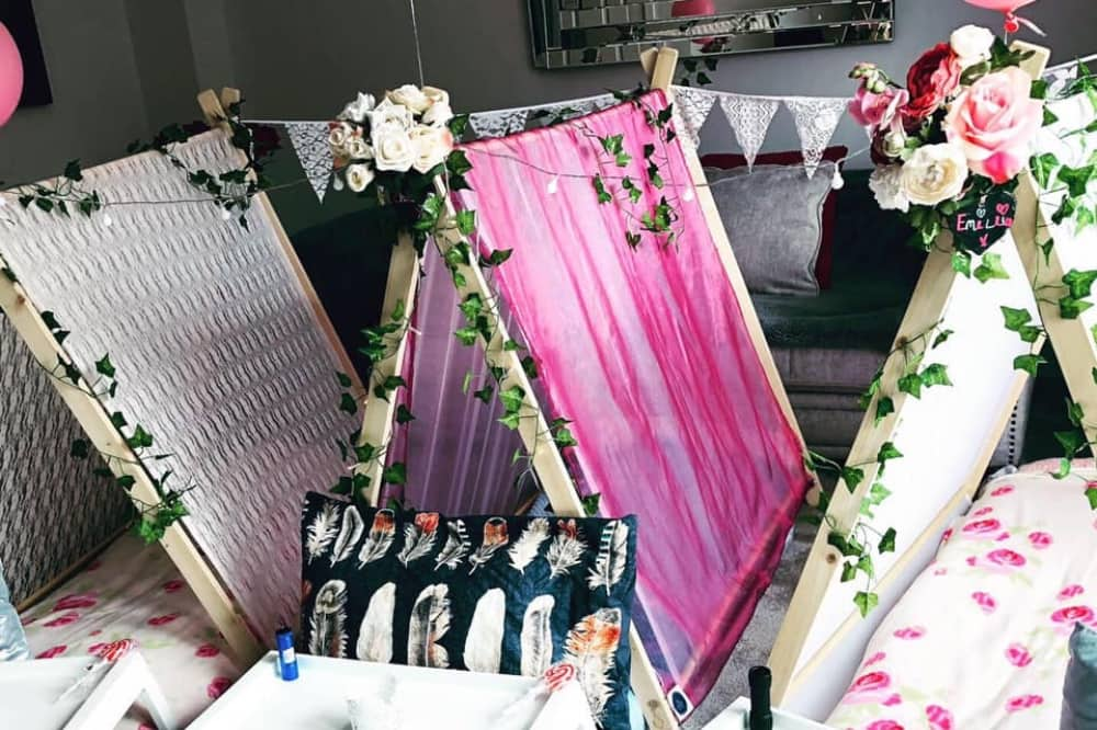 The Sleepover Party People Boho thmese indoor teepees floral garlands fairy lights and bunting