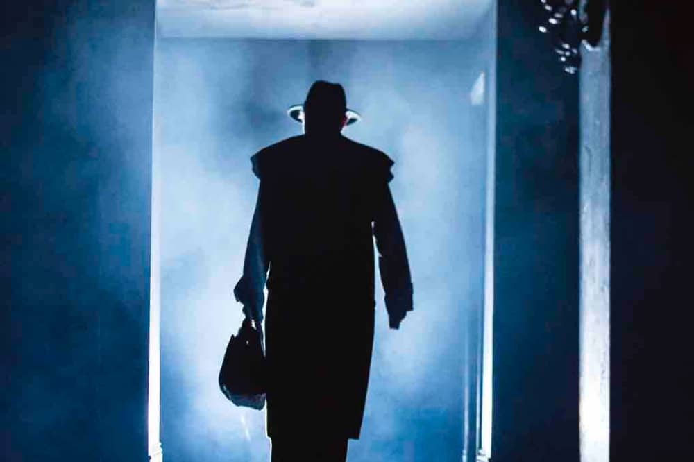 The Exorcist Bill Kenwrght Production Theatre Royal Windsor shadowy figure of demon basher Father Merrin