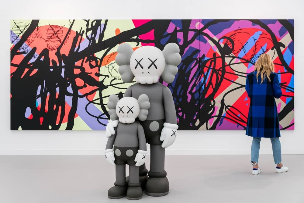 Frieze Art Fair London 2019 sculpture of cartoon like characters and graffIti urban art canvas on wall