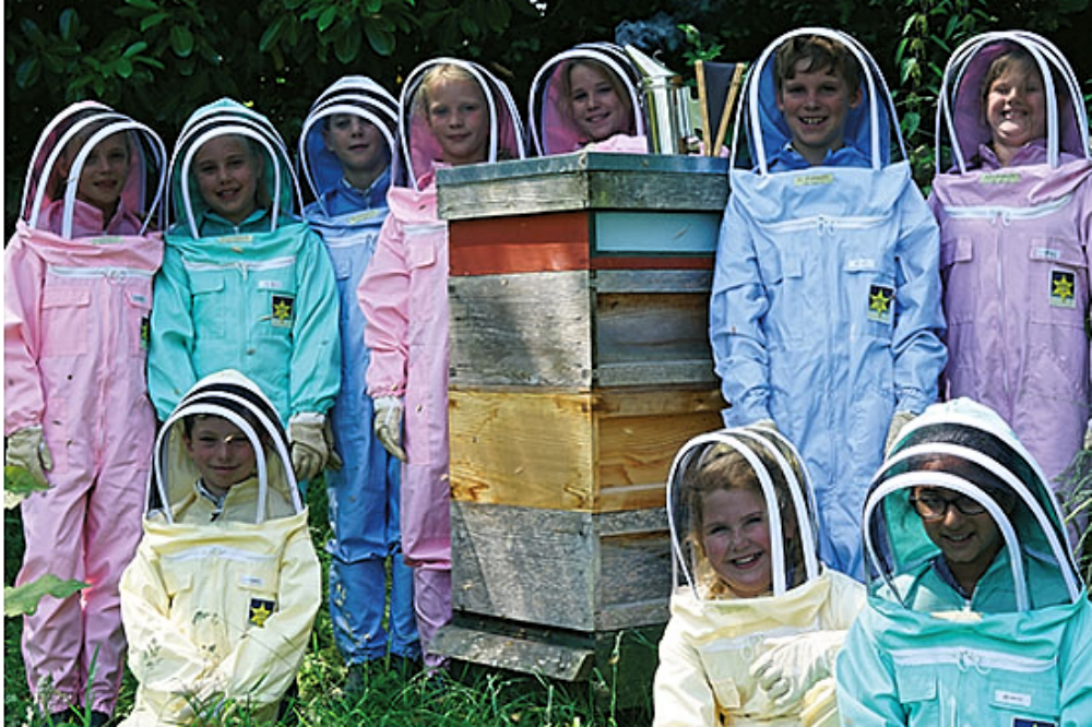 Lambrook School pupils with beehives