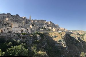 Matera-panorama- itlaina buildings on hill blue sky