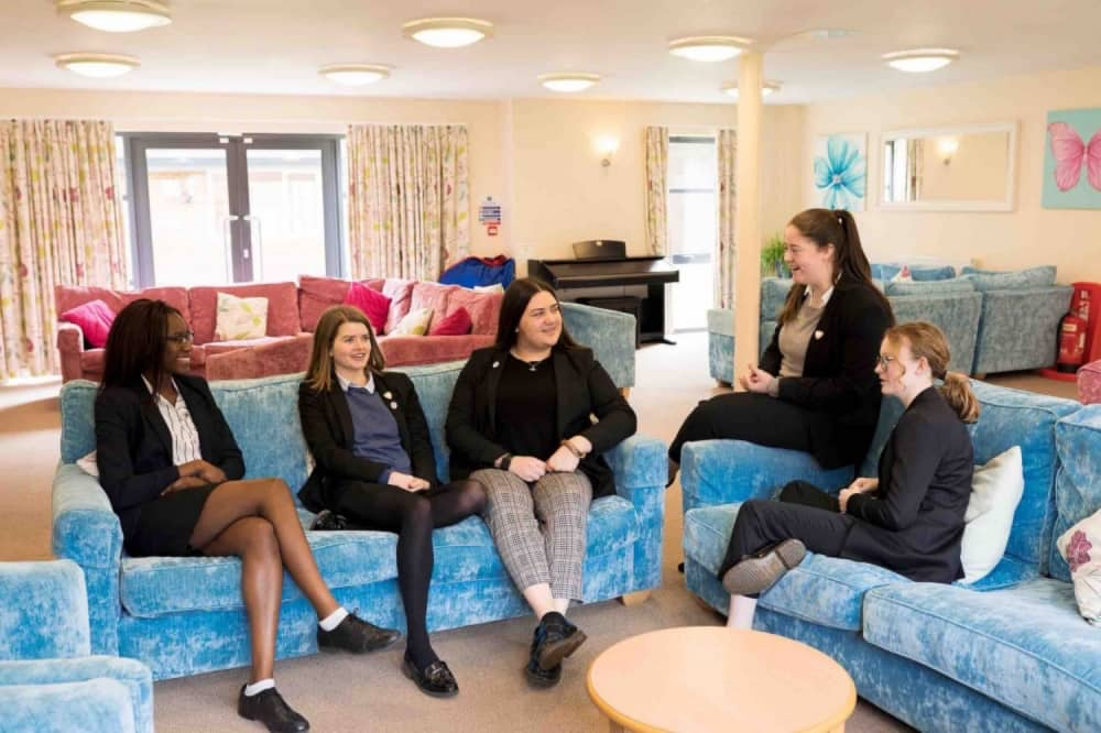 Queen Anne's Caversham girls school Berkshire Boarding House blue and pink sofas large common room