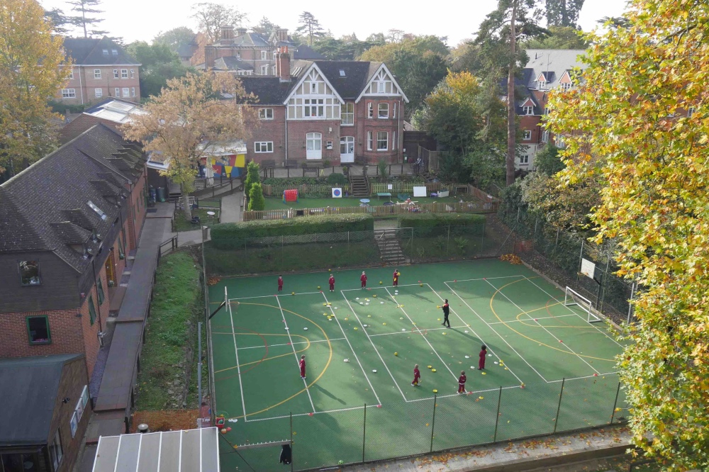 AERIAL VIEW OF ST EDWARD'S PREP READING Victorian villa, modern addition astro turf pitch and trees