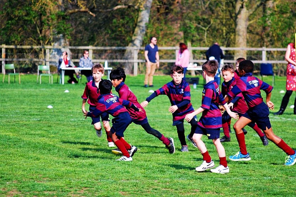 St Edward's prep Reading Sulhampstead playing field burgundy and Reading stripe PE kit