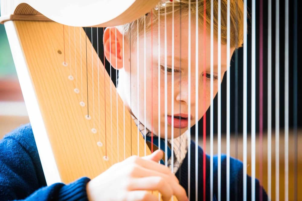 St John's Beaumont Old Windsor Berkshire boy playing Harp
