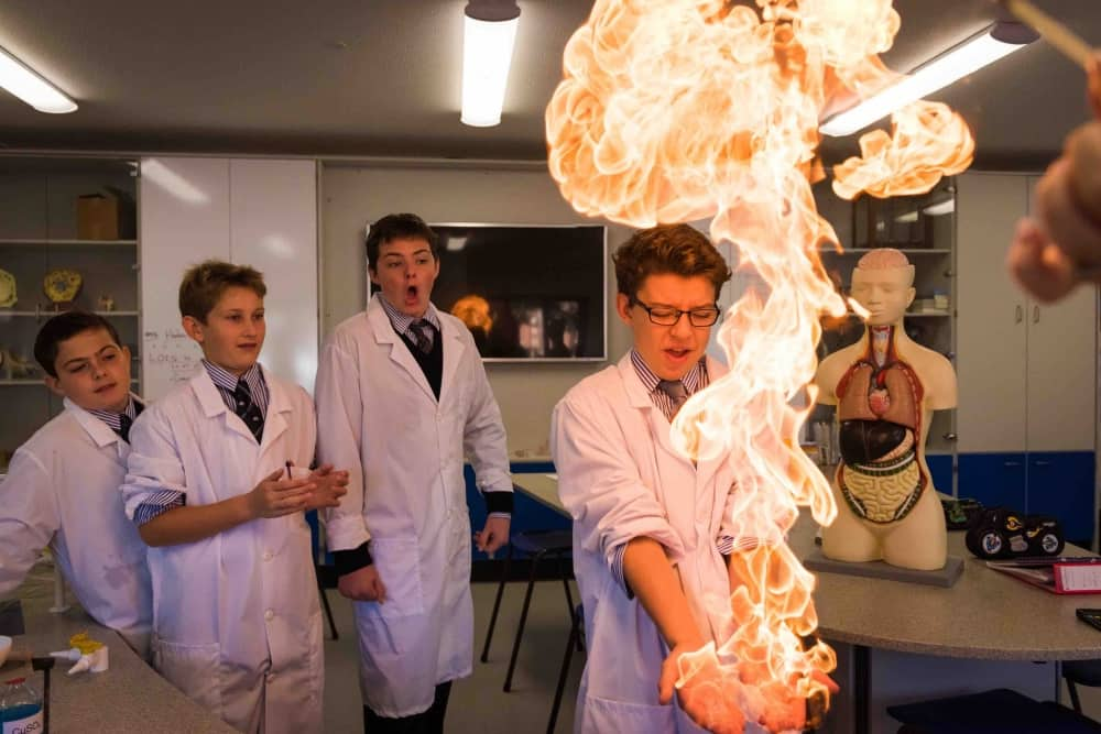 St John's Beaumont Old Windsor Berkshire Science lesson boys in lab coats playing with fire