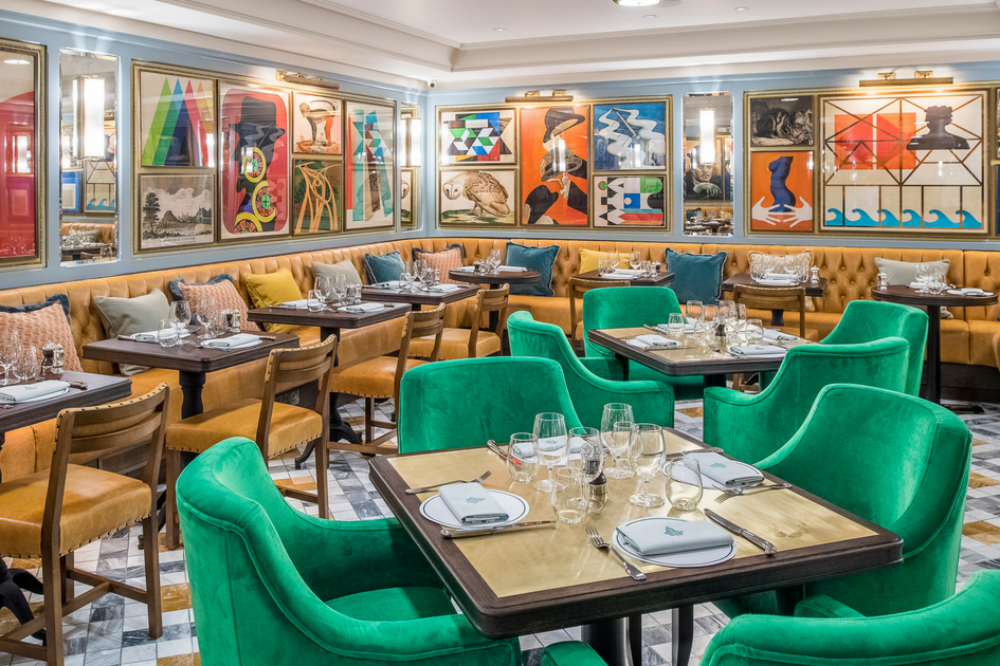 The Ivy Collection contemporary artwork green velvet chairs and mustard velvet banquettes