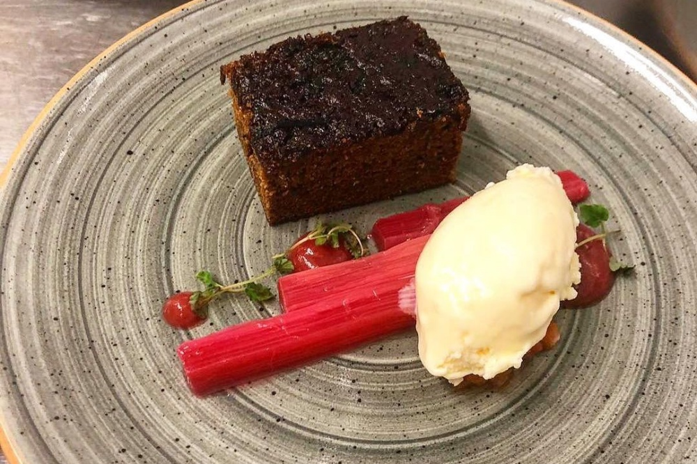 The Pantry Supper Club Yattendon Berkshire rhubarb and ginger cake pudding on textured grey beige plate