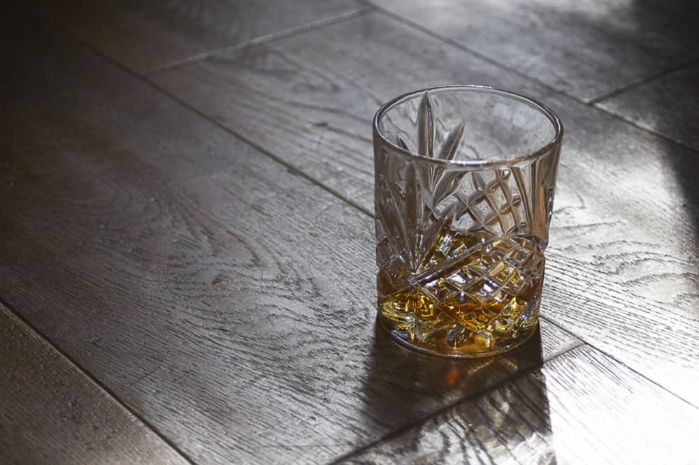 Whiskey crystal glass wooden floor The Cineyard Whiskey and cheese masterclass