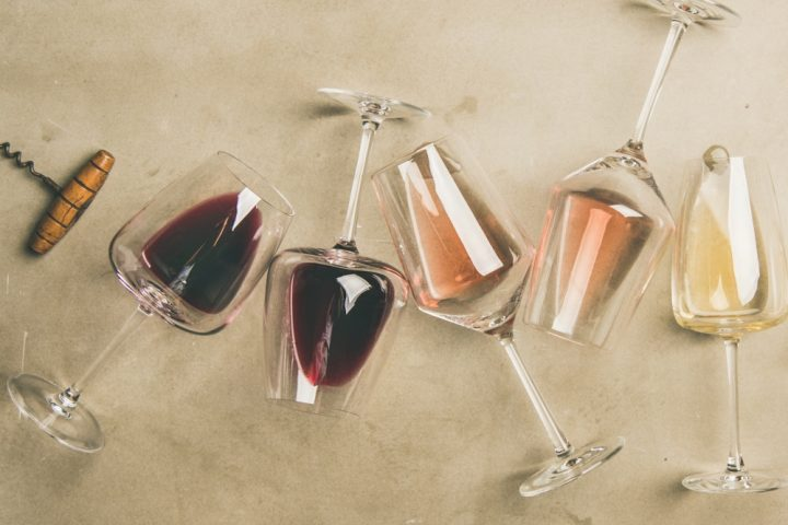 glasses of wine red white rose corkscrew flatlay