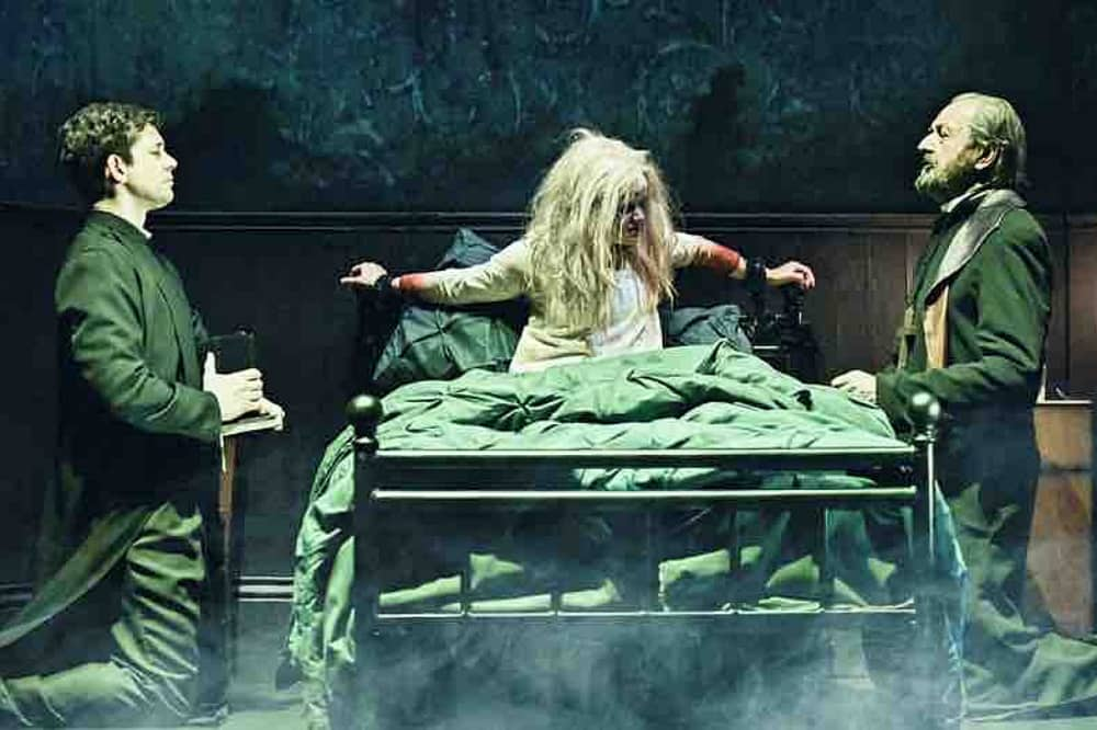 THE EXORCIST stage play London 2017 Regan andtwo prists at herbedside