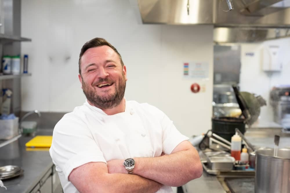 Executive Head Chef Cliveden House Hotel Berkshire Paul O'Neill chef whites arms folded laughing