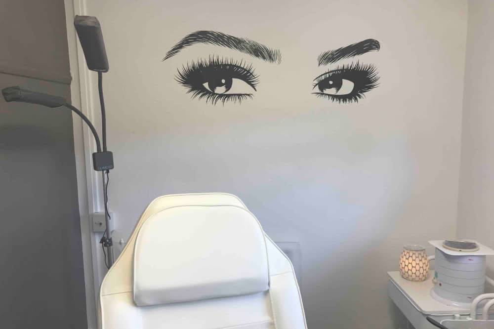 Beauty Box treatment room eye stickers on wall and white chair