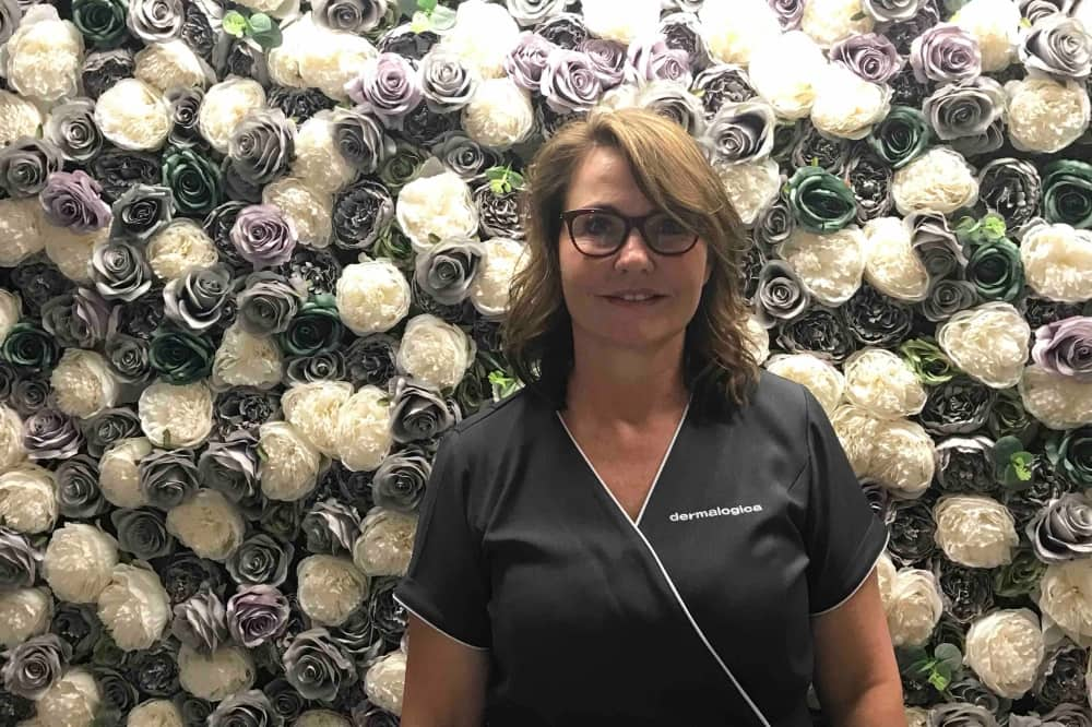 Owner Annie brunette short hair with glasses floral wall Beauty Box Pangbourne