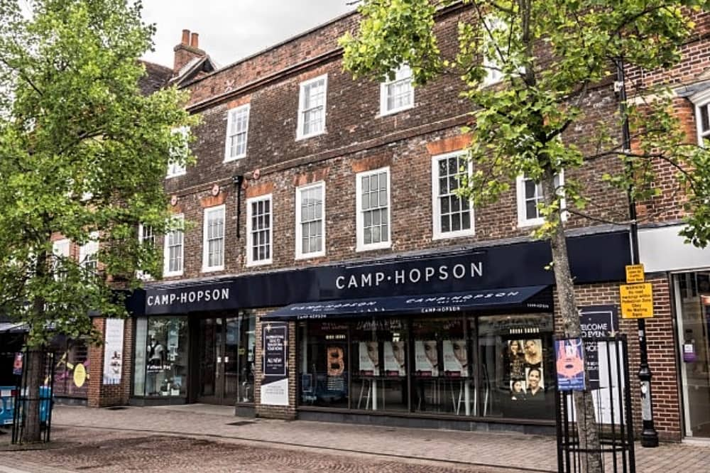 Camp Hopson Newbury department store brick victorian building blue branding and trees