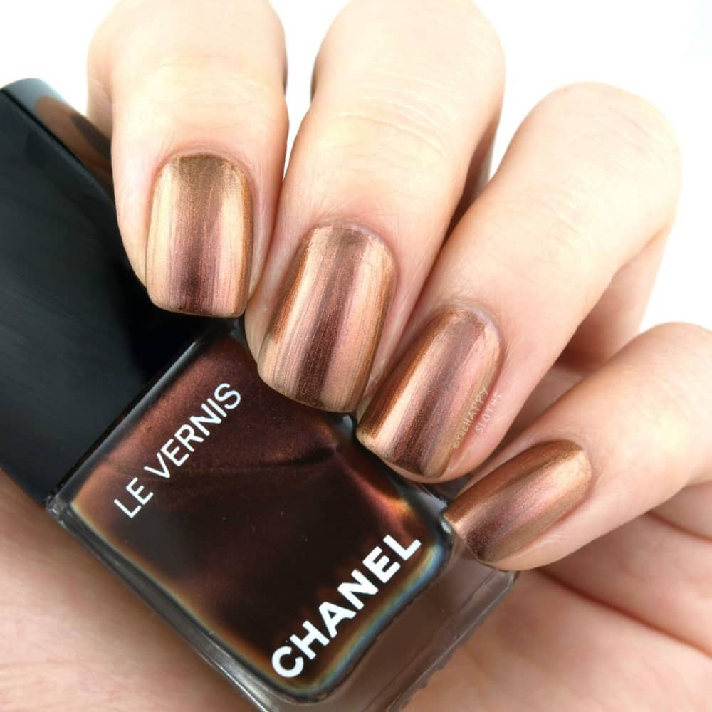 Chanel nail polish and hand with painted nail in opulence
