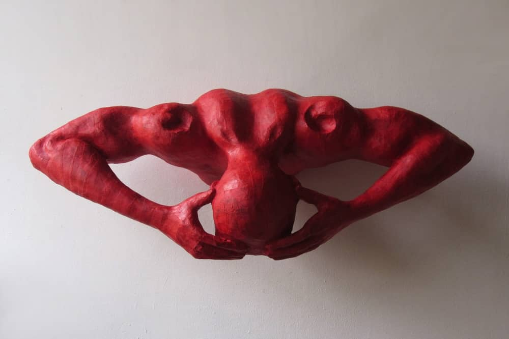 Contemporary Art Fair Spirit of Moutnains red paper maiche sculpture of red person head in hands