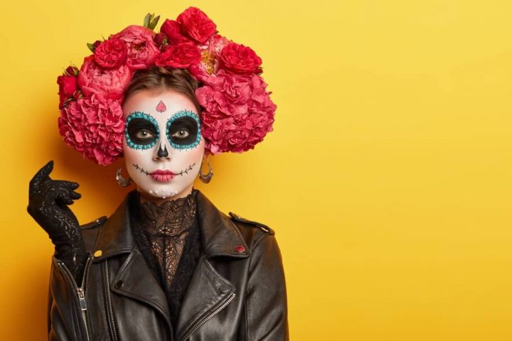 woman in Day of the dead costume and make up with floral crown