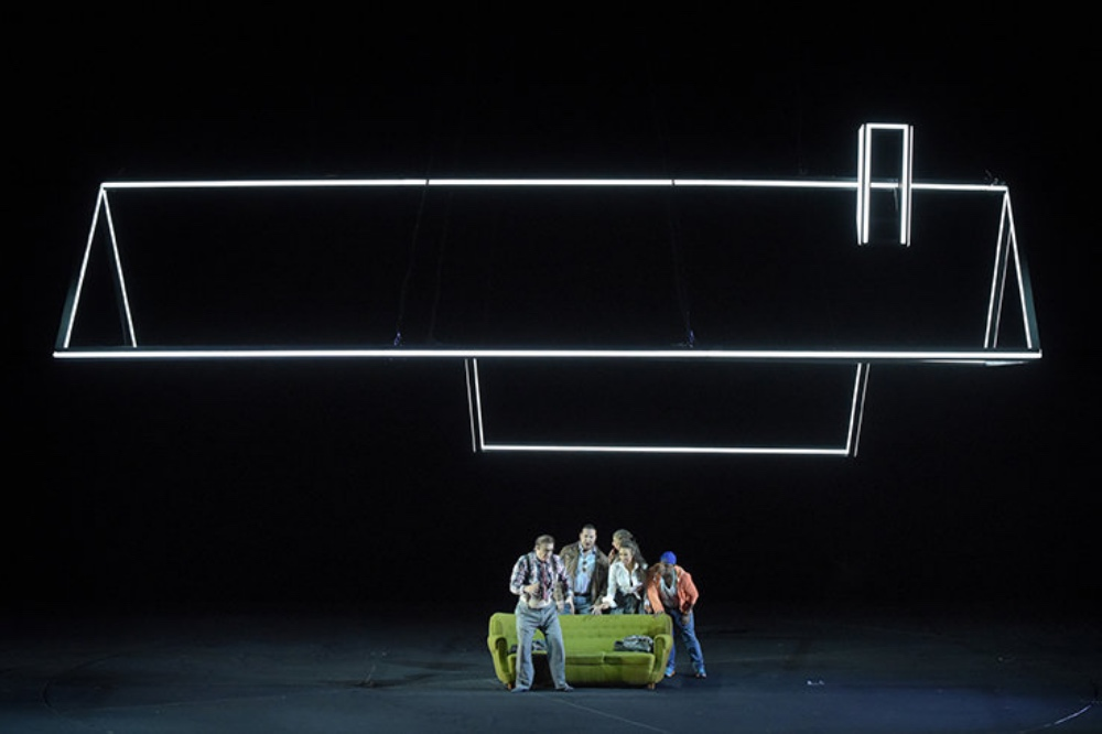 Don-Pasquale-ROH LIve illuminated outline of rook people huddled underneath