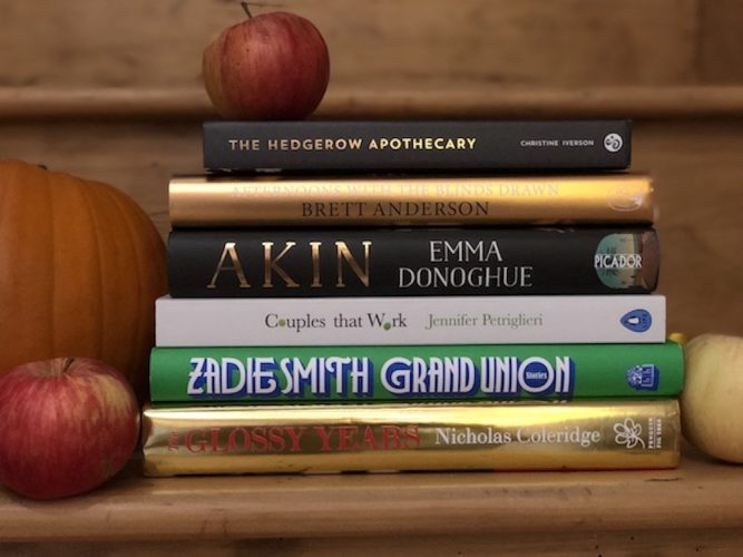 Stack of books on a shelf with October new releases