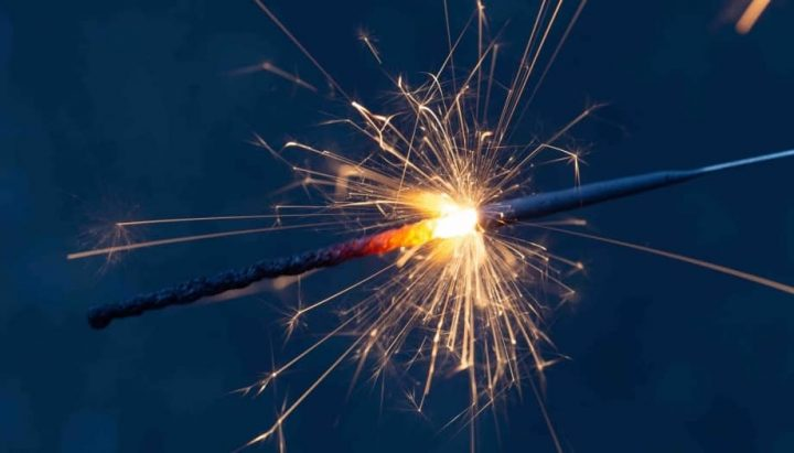 lit sparkler burning down stick