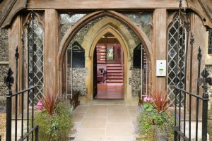 church house Berkshire-entrance church arches leaded winidows