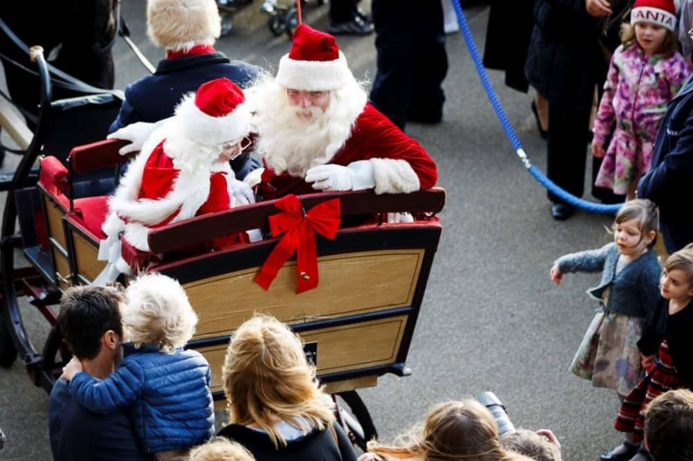 Ascot Racecourse christmas father and mother christmas arriving in sleigh