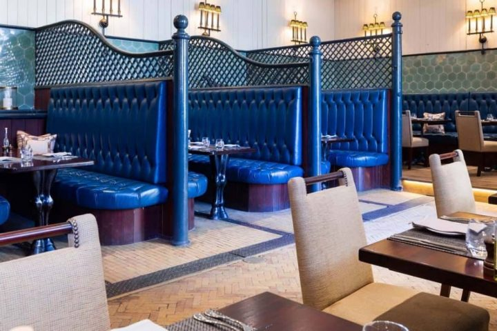 Cliveden House Hotel Astor Grill blue leather stable banquettes and tables and chairs
